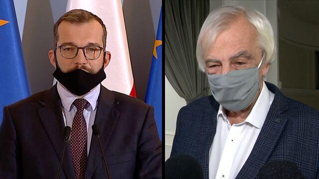 Grzegorz Puda w maseczce i Ryszard Terlecki w maseczce