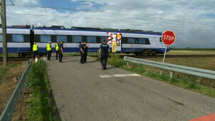 Tragedy on an unguarded crossing. Mother with two children hit by a train